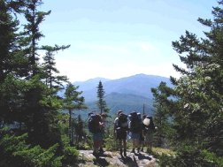 Hiking in the scenic Lakes Region of New Hampshire, the heart of the White Mountain National Forest.